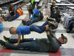 fathers doing yoga with their kids