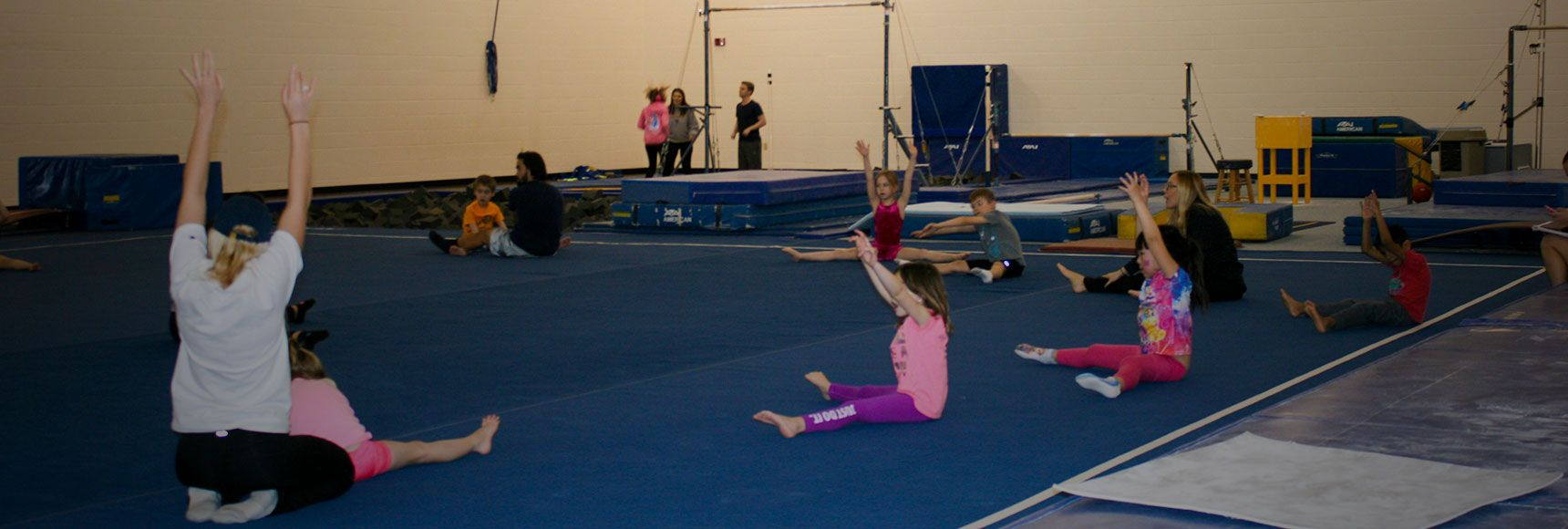 Students stretching for gymnastics class
