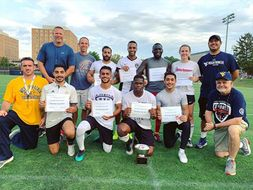 Faculty and students from the winning team pose after the diversity cup