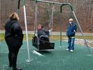 Family members try new adaptive swing in Kanawha State Forest.