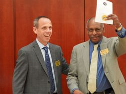 Photo of Dr. Jack Watson and Dean Dana Brooks presenting awards.