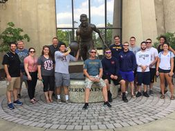 Photo of students in front of Jerry West statue in Morgantown, WV.