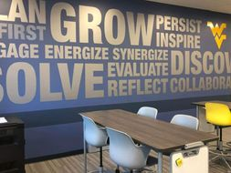 An inspiring mural that urges students to grow and persist located in the back of the ALC