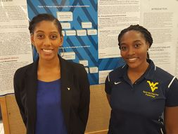 Students presenting their poster during student research day