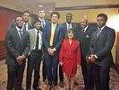 Theresa Scafella standing with members of the WVU Basketball Team