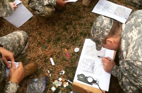 ROTC Student reading a map