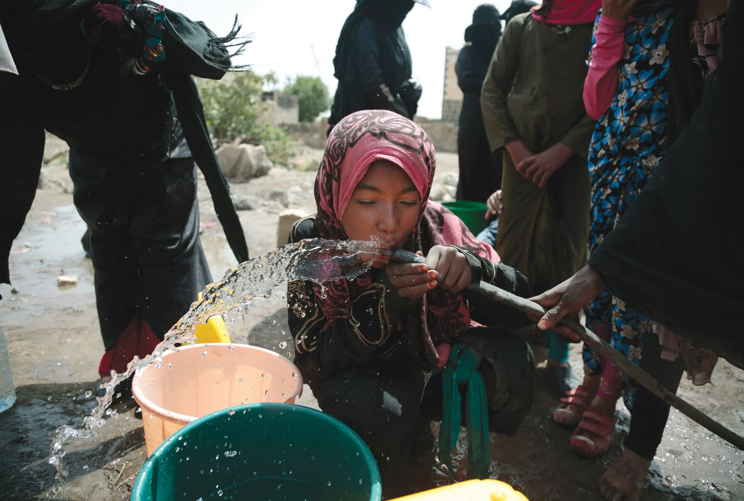 A GIRL DRINKS WATER ALLEGED TO CONTAIN THE BACTERIUM VIBRIO CHOLERA ON THE OUTSKIRTS OF SANAA, YEMEN (ASSOCIATED PRESS PHOTO).