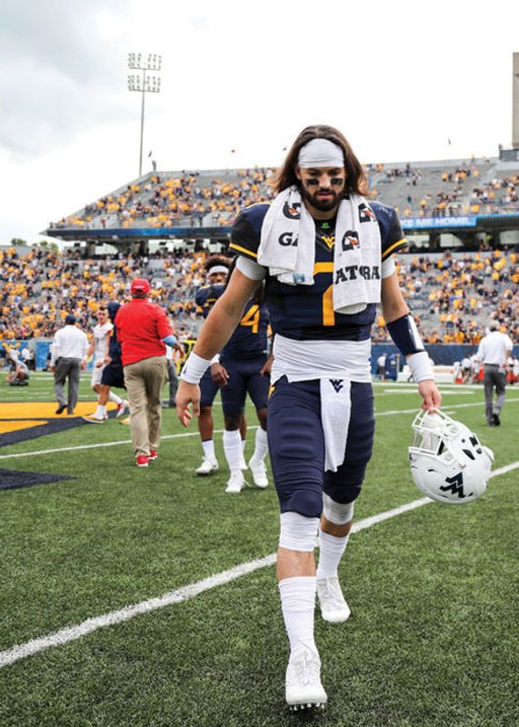 Will Grier walking on the field after a game.