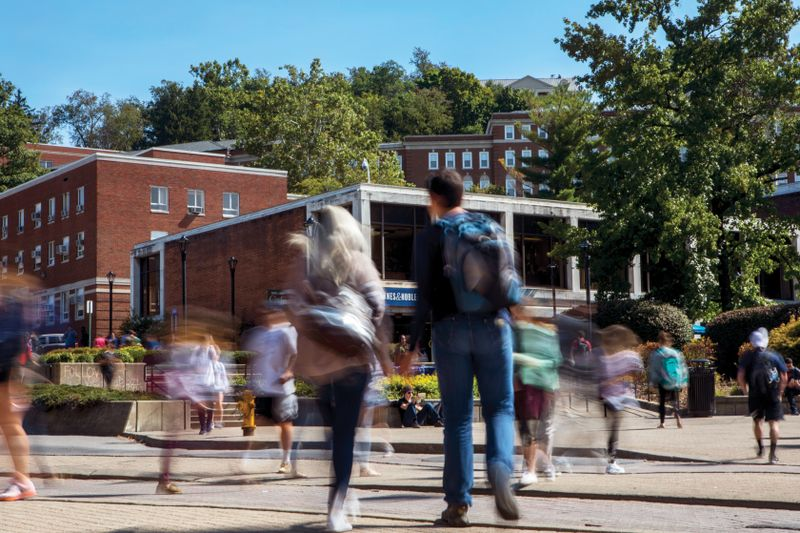 Blurred student movement at crossing in front of Mountainlair.