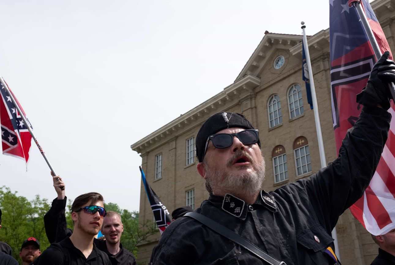 Members of the neo-Nazi group, the National Socialist Movement, face-off with counter-protestors in downtown Pikeville, Ky., on Saturday, April 29, 2017. (Photographed by Joel Beeson)