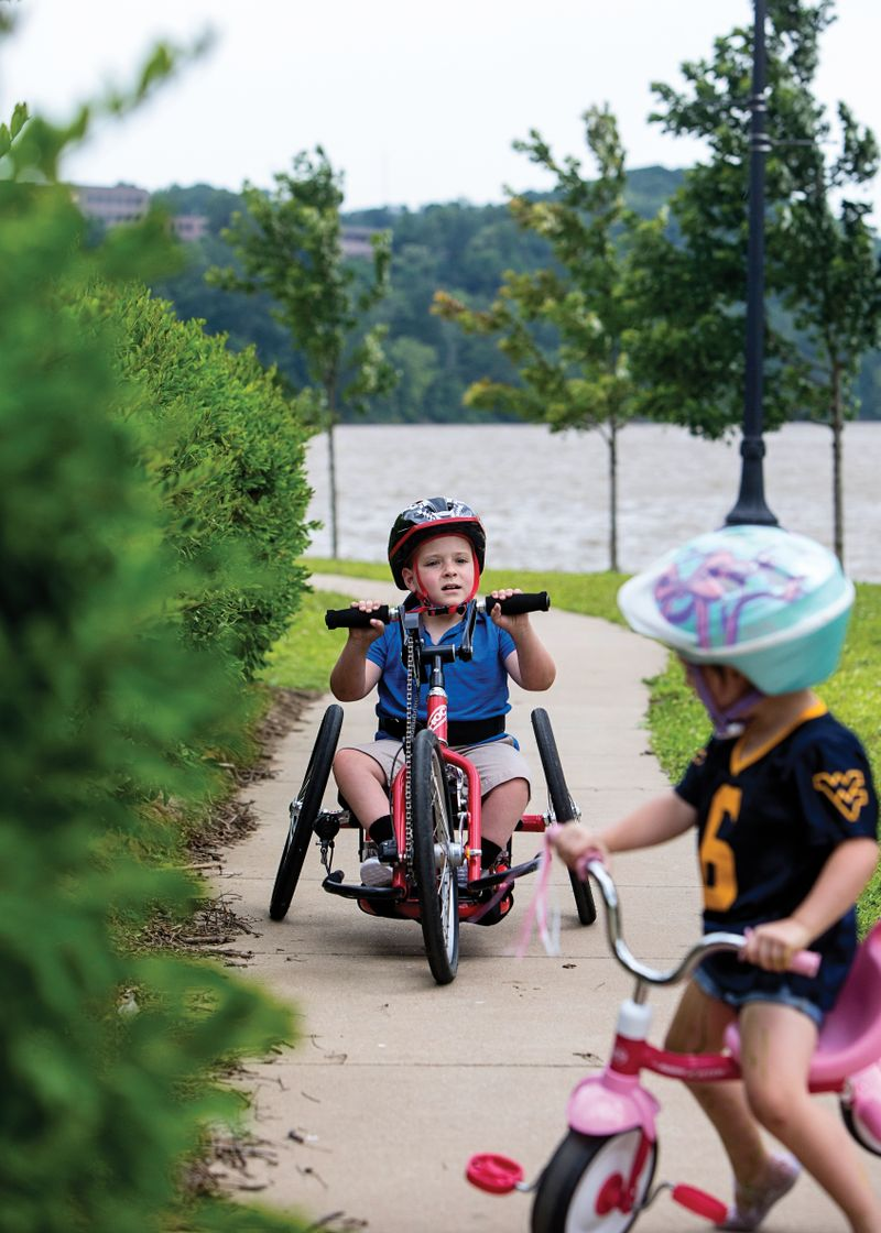 Brantly Poling, 7, uses his handcycle