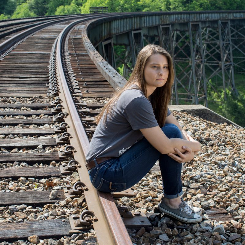 Savannah Lusk on train trestle