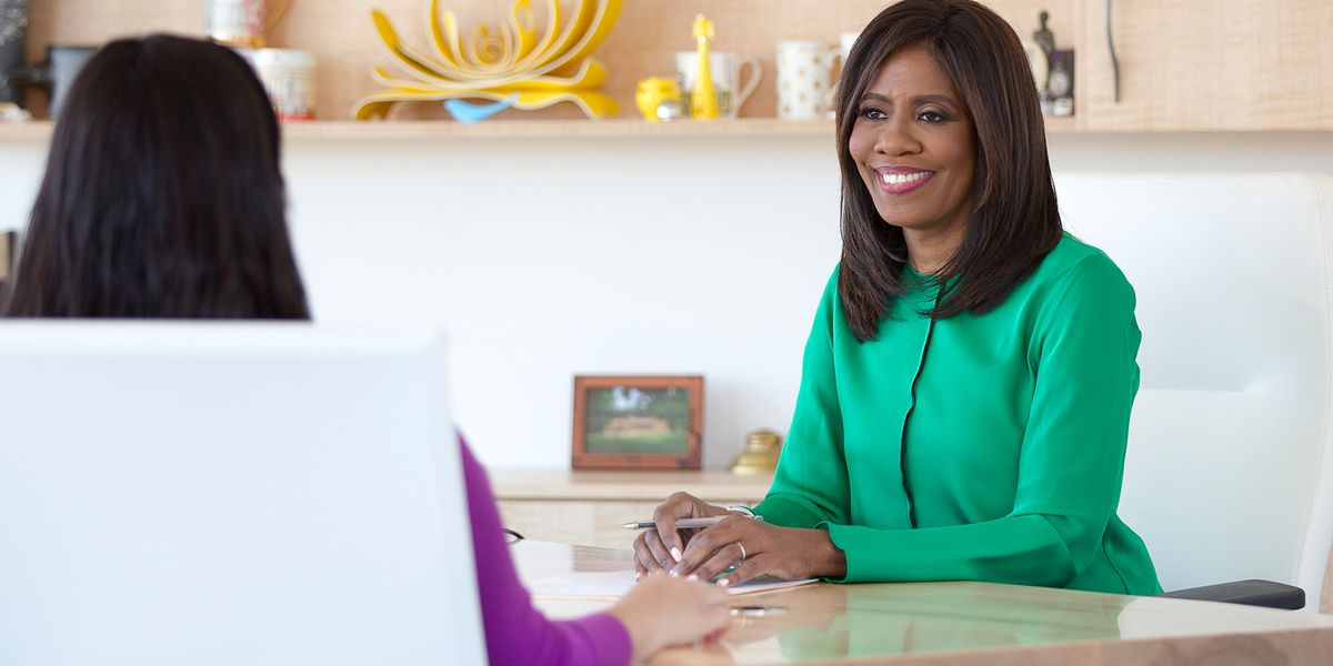 Patrice Harris talks with person across table.