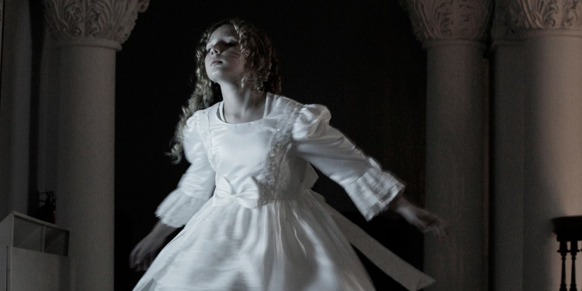 A ghostly girl spins in her party dress.