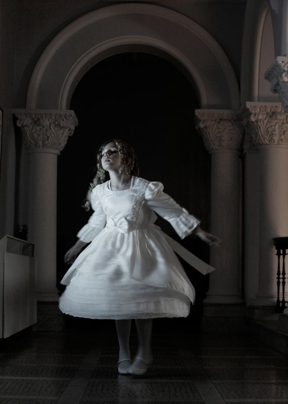 A ghostly girl spins in her party dress at Stewart Hall.