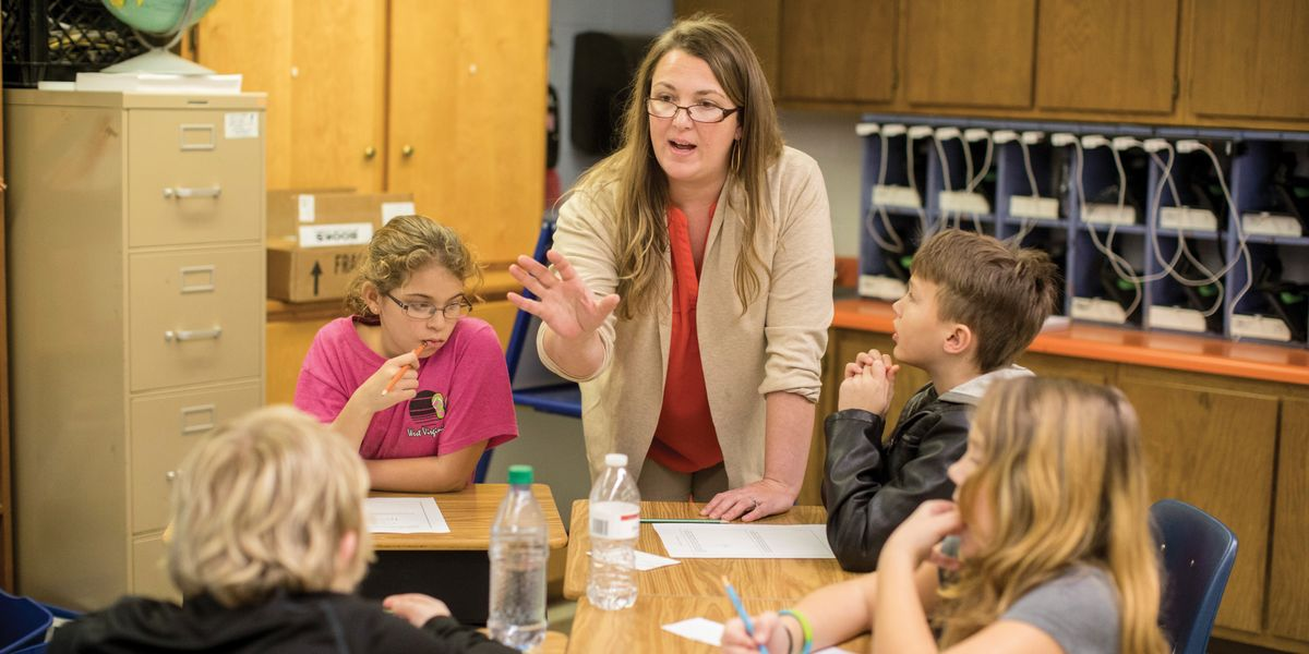 Joanna Burt-Kinderman teaches math in a classroom.