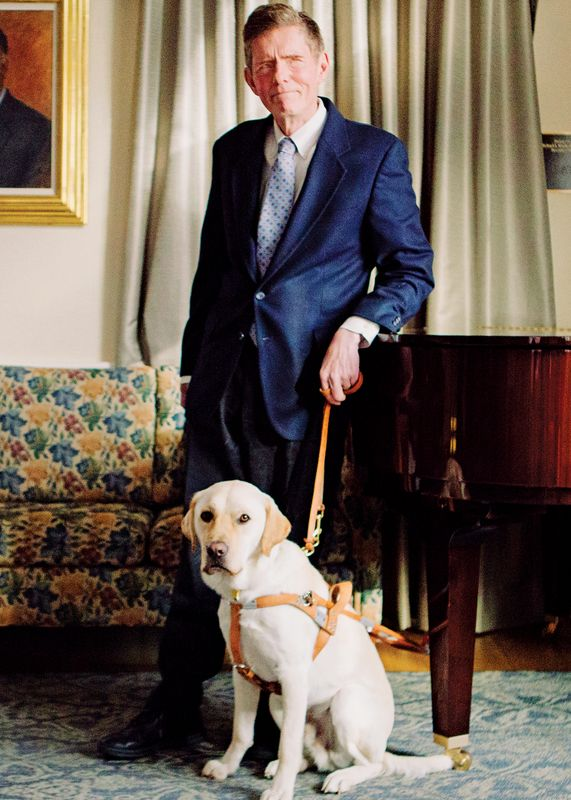 Jim Kutsch standing with guide dog at The Seeing Eye.