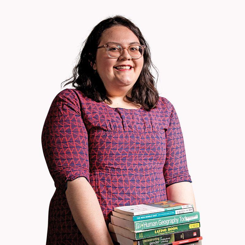 Kassie Colón holds books