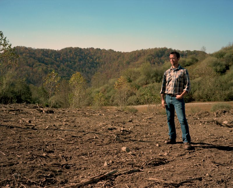 Ben Gilmer stands on land that Refresh Appalachia is reworking for agriculture.
