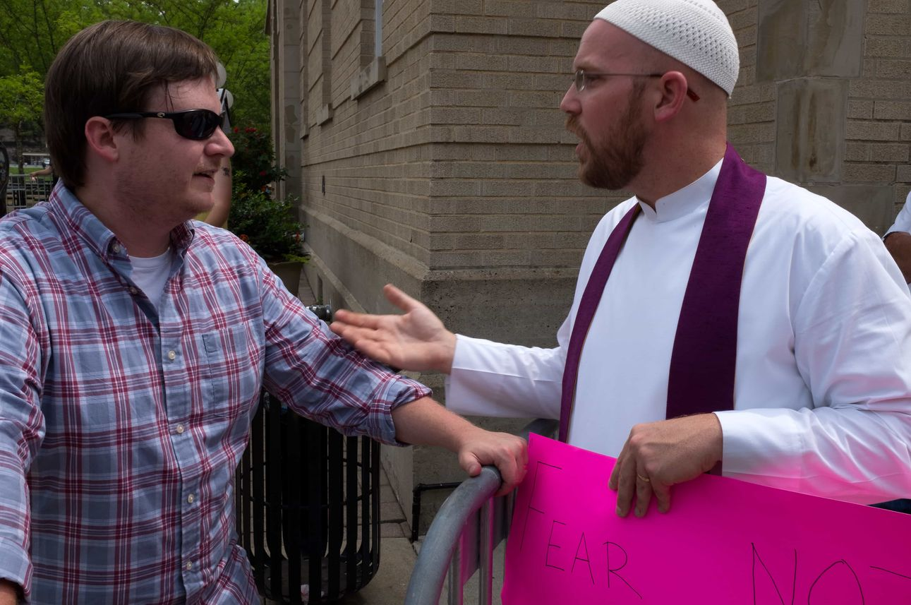 During the faceoff between the alliance of white nationalist and anti-fascist demonstrators in downtown Pikeville, Rob Musick, campus chaplain and religion instructor at the University of Pikeville talks with Brad Griffin, of Eufaula, Ala., who runs the w