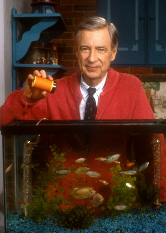 Mister Rogers feeds the fish photo