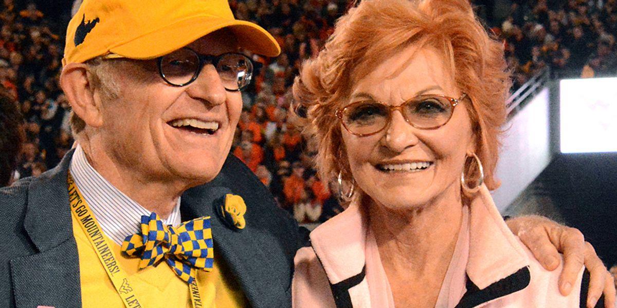 Gordon Gee with an arm around Betty Puskar at a football game.