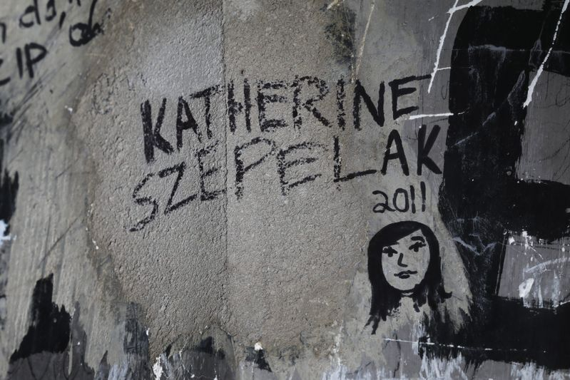 Katherine Szepelak signed her name and drew a self-portrait in 2011.