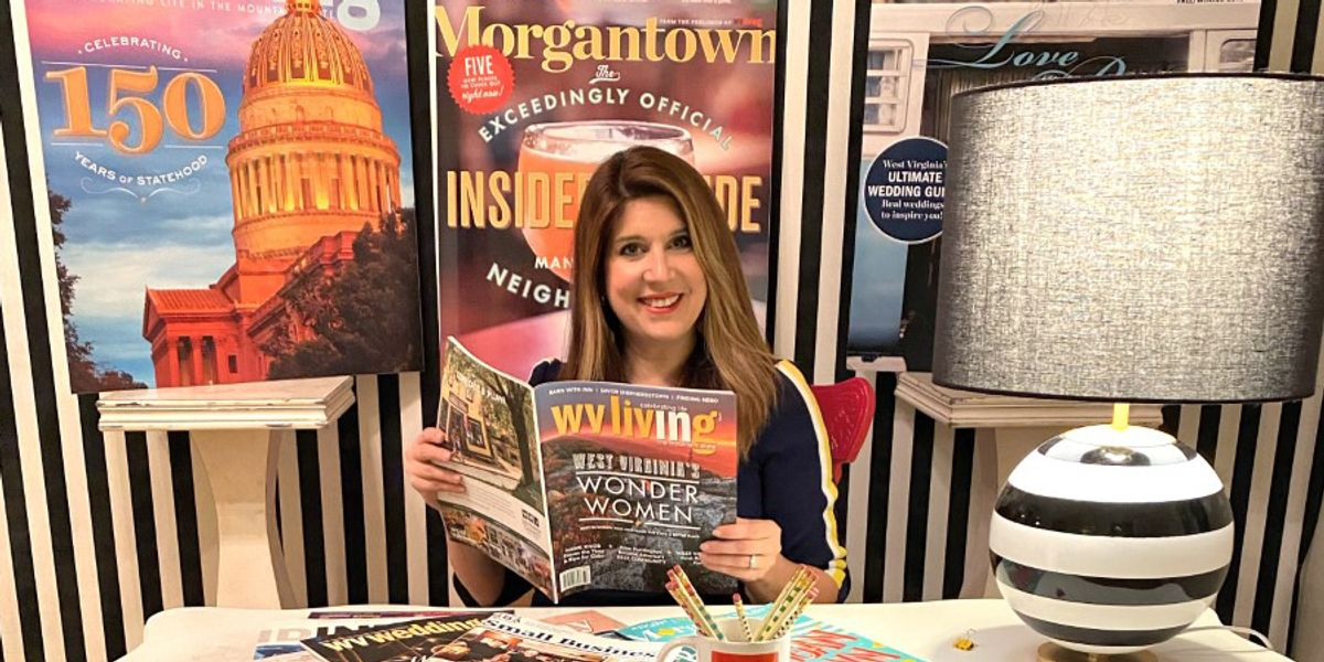 Nikki Bowman holding a magazine in her office.