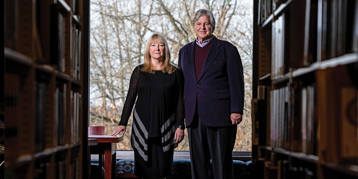 Suzanne Weise and Pat McGinley stand in the law library at WVU.