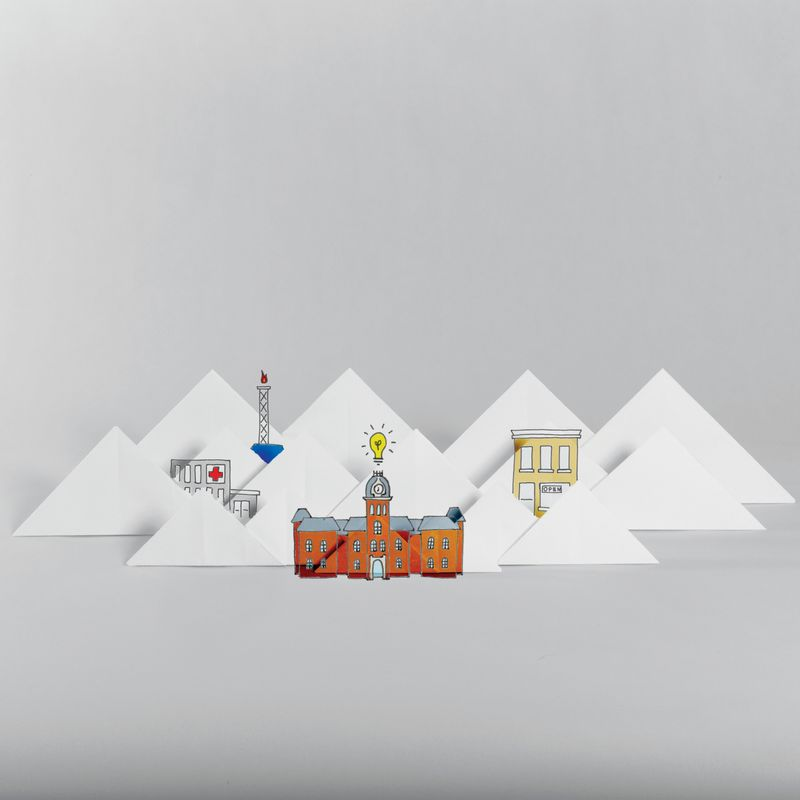Depiction of Woodburn hall, mountains, gas well and downtown in origami.