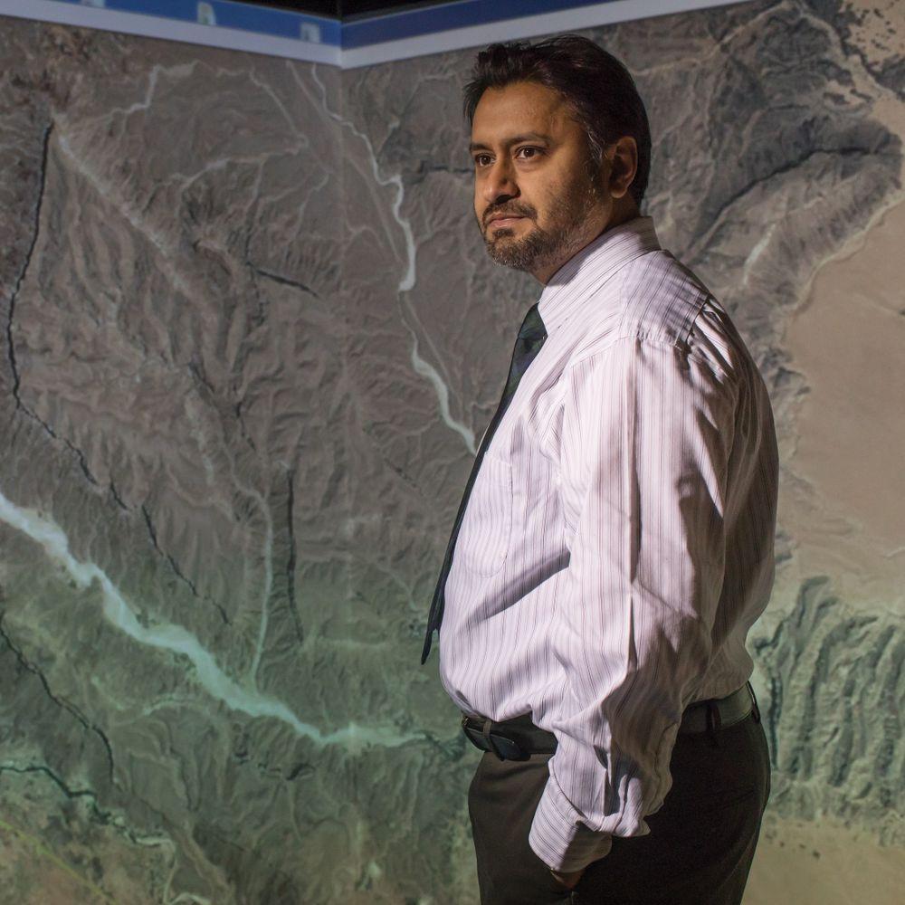 Antar Jutla in front of a map of Yemen.