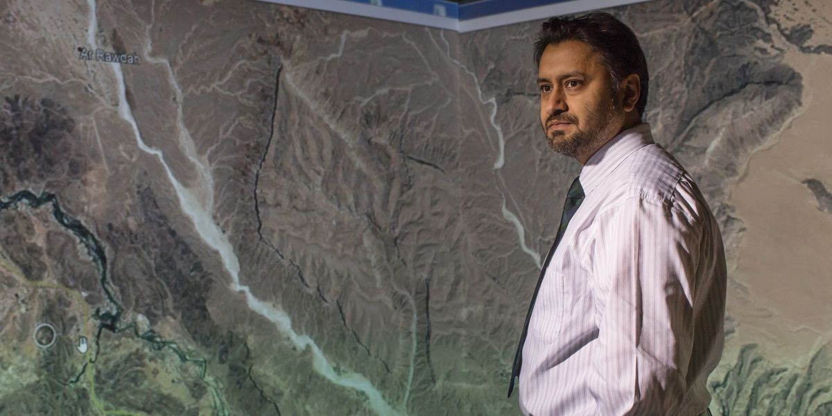 Antar Jutla in front of a map of Yemen.