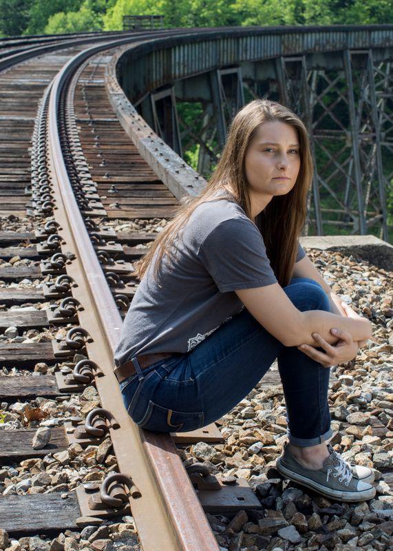 Savannah Lusk on train track