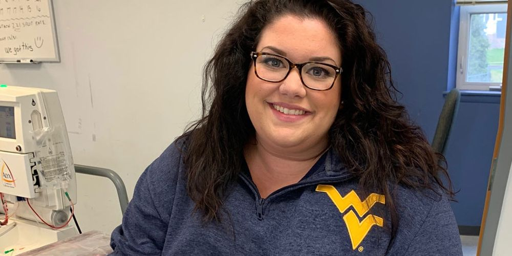 Marisa Leuzzi in a Flying WV sweatshirt at a doctor's office.