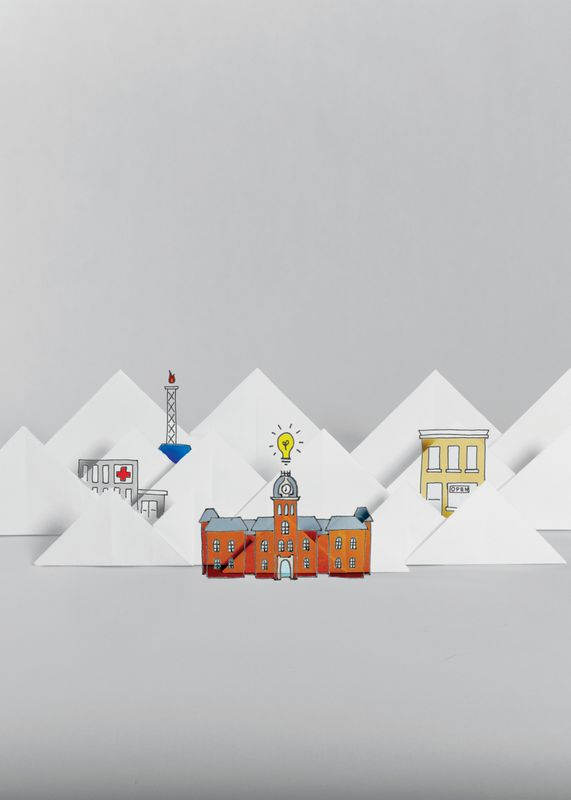 Origami depiction of mountains, Woodburn hall, gas well and downtown.
