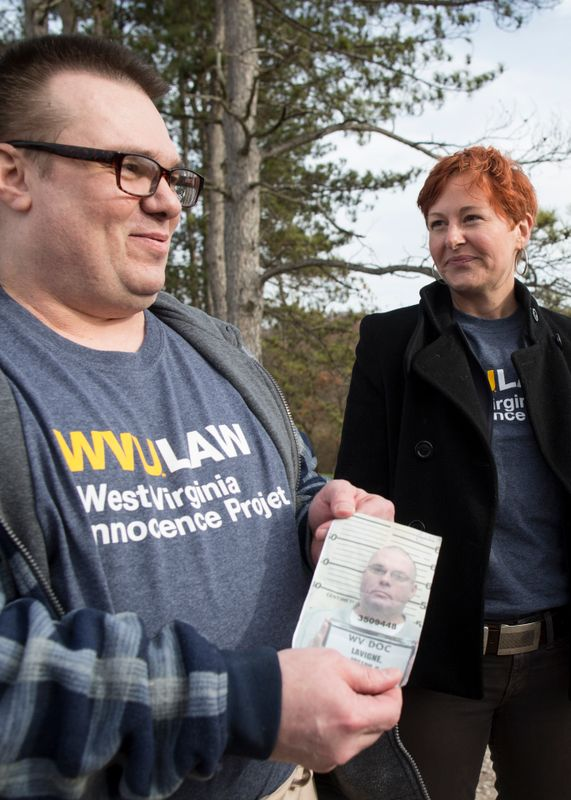 Photo of Joe Lavigne out of prison holding a photo of himself with attorney Valena Beety