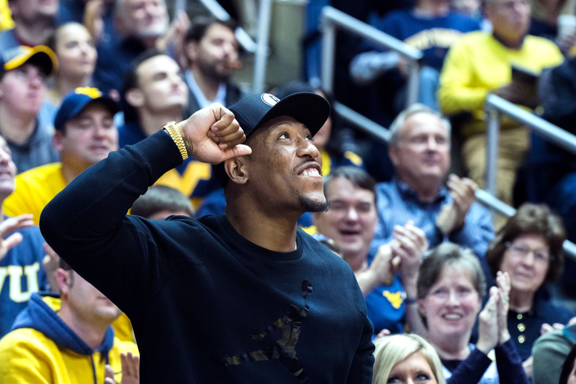 Bruce Irvin attends a WVU basketball game.