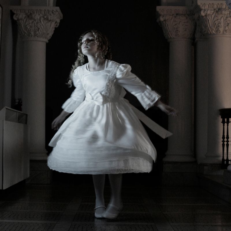 Ghostly girl spins in her party dress at Stewart Hall.
