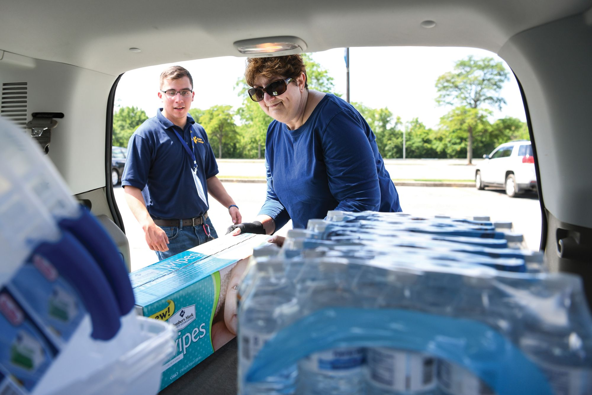 Volunteers collect donations for flood relief.
