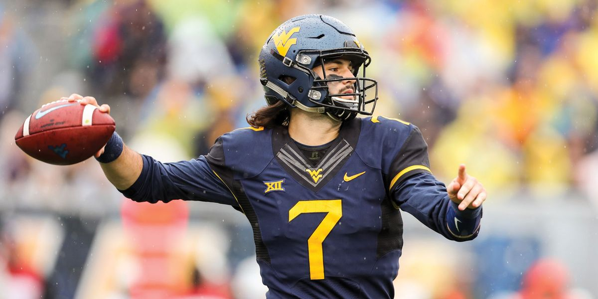 Will Grier throwing a football