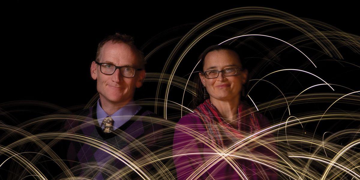 Duncan Lorimer and Maura McLaughlin among spinning lights.