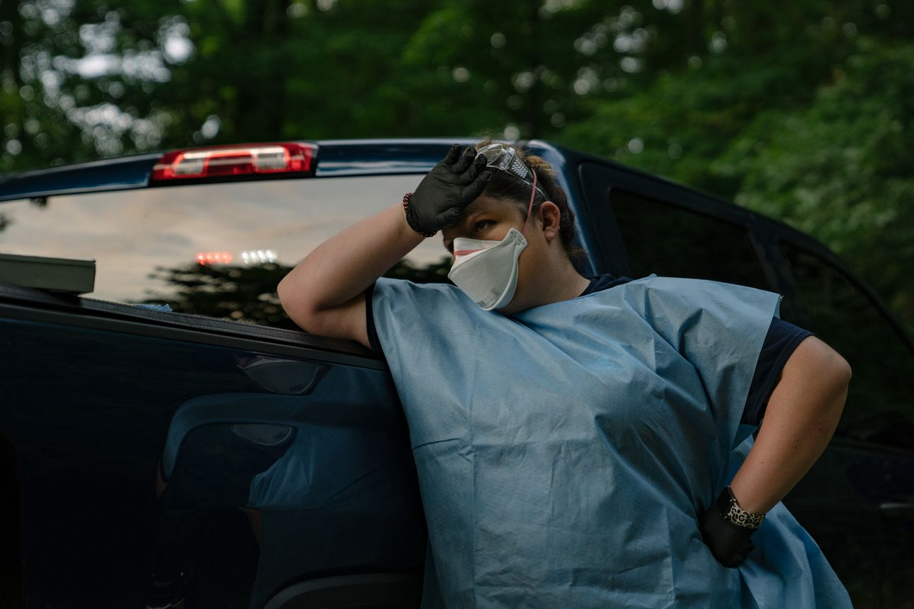 A Marion County EMS medic waits for the county medical examiner to arrive on the scene of a deceased man believed to have been infected with COVID-19 on August 6th, 2020.