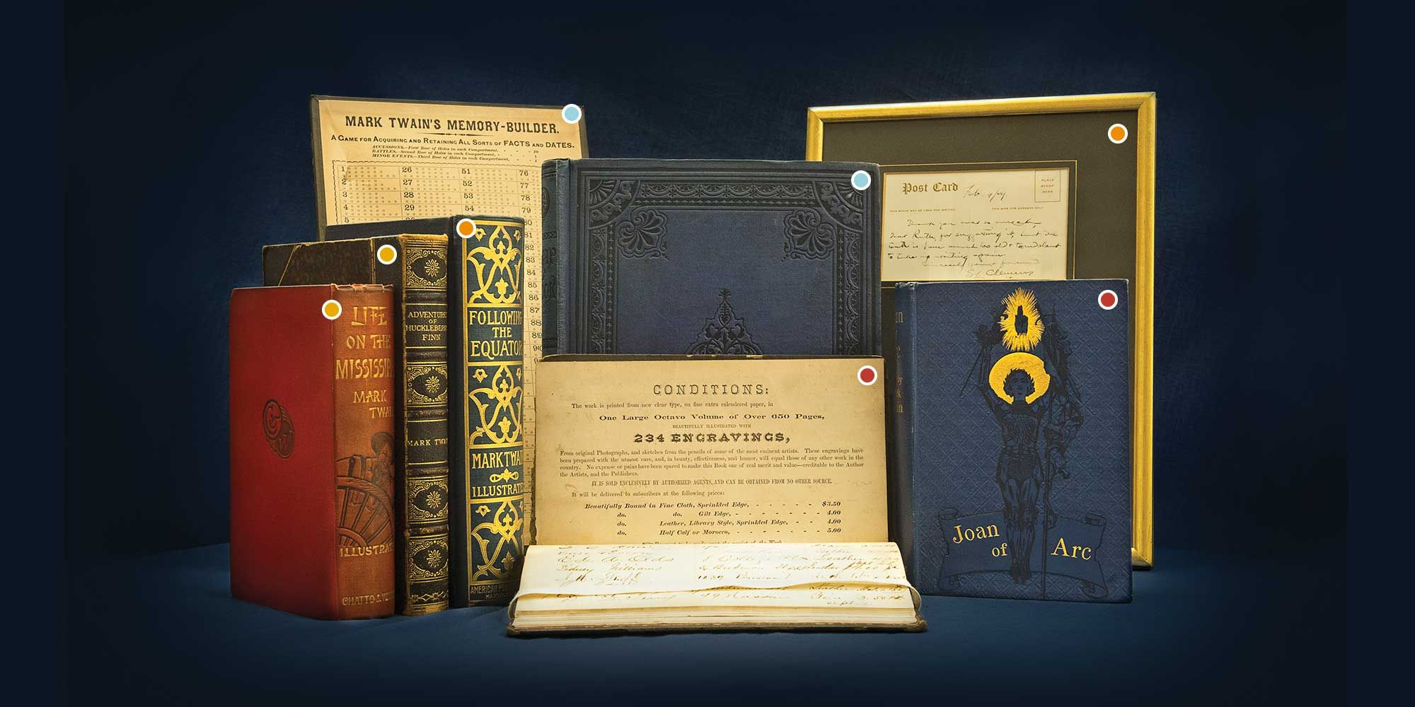 Books and items from the Mark Twain Collection at WVU Libraries.