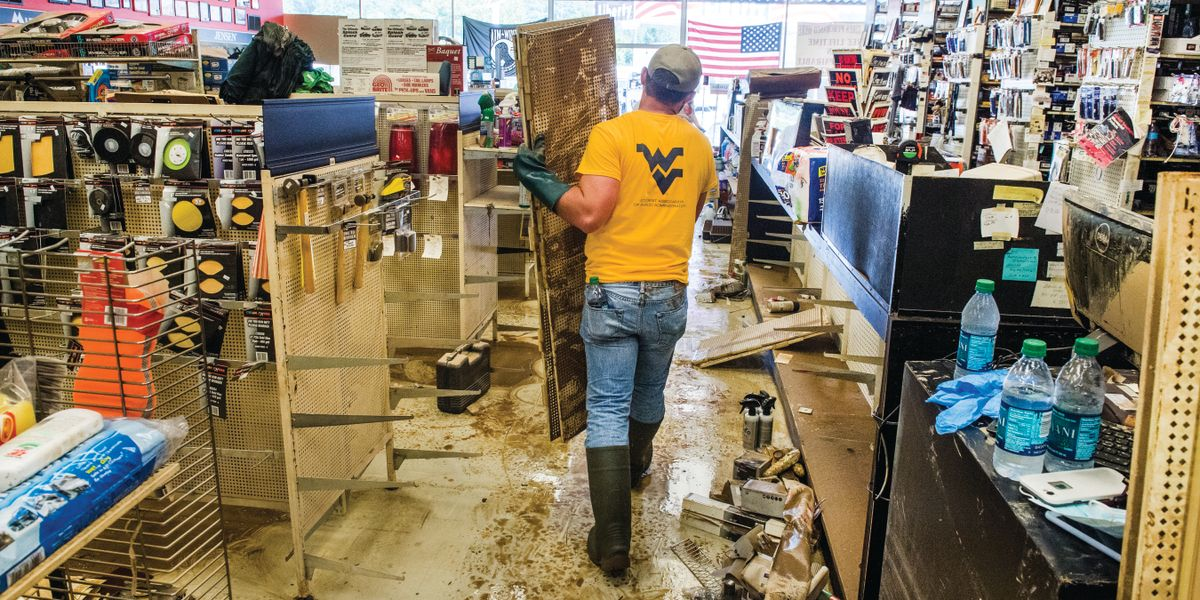 Student cleaning flooded store.