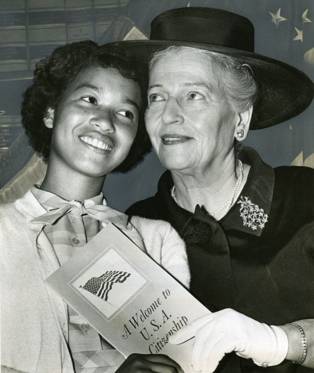 Pearl S. Buck accompanies one of her adopted children, Chieko Usaki Walsh, formerly of Japan to a naturalization event, June 6, 1962