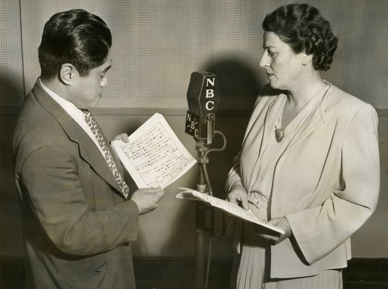Jen Ying Yen, Chinese journalist, reads his part in the script America Speaks to China as Pearl Buck, author of the play, looks on. These NBC dramas, eight in all, are sponsored by the East and West Association and will be short waved to China, August 21, 1942
