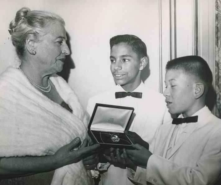 David and Leon Yoder the first two children taken into the Welcome House family in 1949 present a locket of friendship to Pearl buck, May 5, 1960