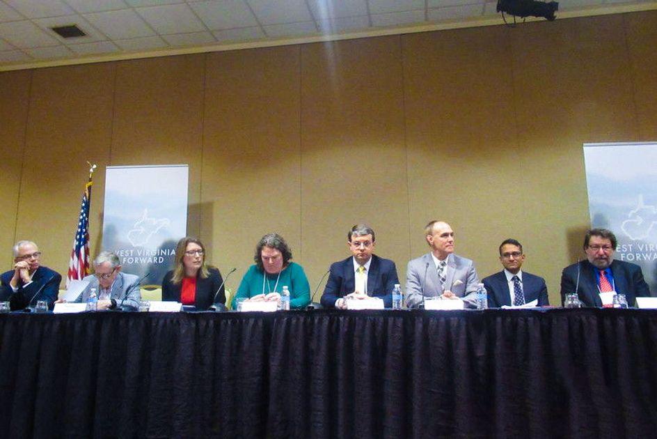 (Left to right) Jerome Gilbert, Gordon Gee, Erika Klose,Sarah Tucker, Roger Hanshaw, Mitch Carmichael, Kartik Athreya, and Mark Kamlet