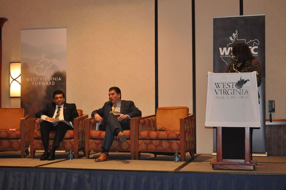 Avinandan Mukherjee, Marshall's Dean of the Lewis College of Business, and Javier Reyes, WVU's Dean of the John Chambers College of Business and Economics, participate in a panel, moderated by WVU Provost Joyce McConnell, during the WV Legislators' Forum