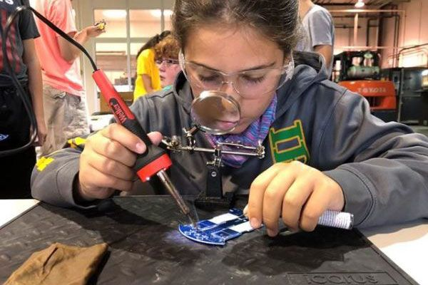 Kid soldering in activity